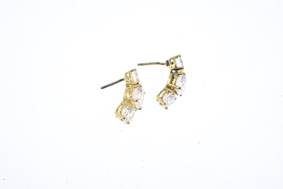 A pair of cubic zirconia earrings. Each designed as a - 2