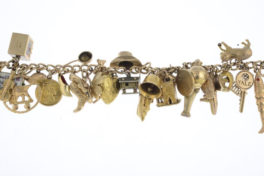 A charm bracelet. The curb-link chain, suspending a - 2