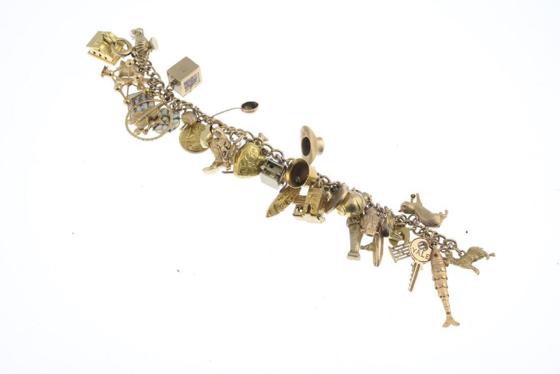 A charm bracelet. The curb-link chain, suspending a - 3
