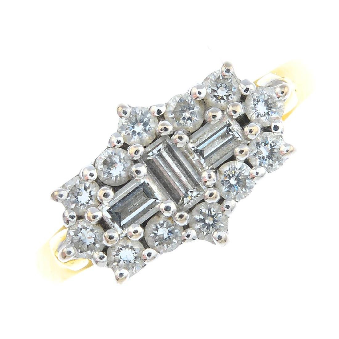 An 18ct gold diamond dress ring. The alternating