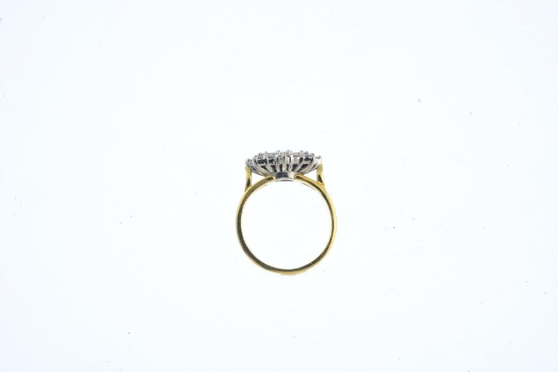 An 18ct gold diamond dress ring. The alternating - 2