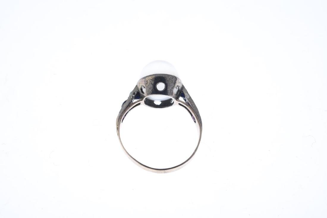 A mid 20th century moonstone and gem-set ring. The oval - 2