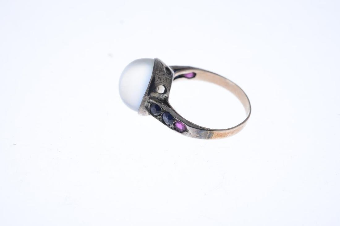 A mid 20th century moonstone and gem-set ring. The oval - 3