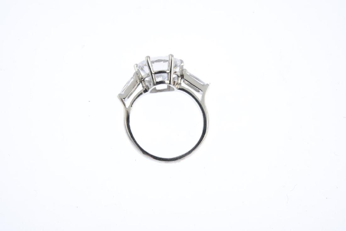 A 9ct gold cubic zirconia three-stone ring. The - 2