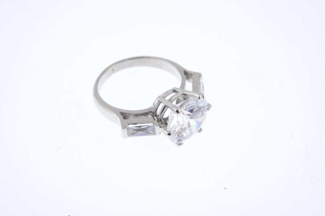 A 9ct gold cubic zirconia three-stone ring. The - 3