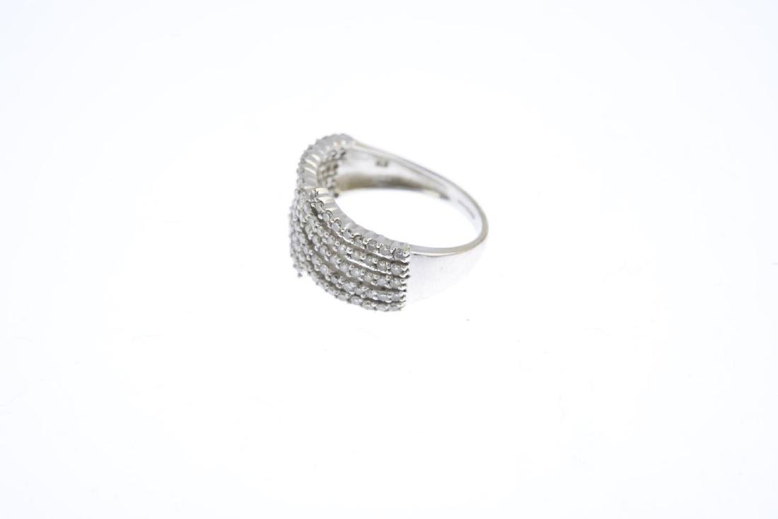 A 9ct gold diamond dress ring. Designed as a series of - 2