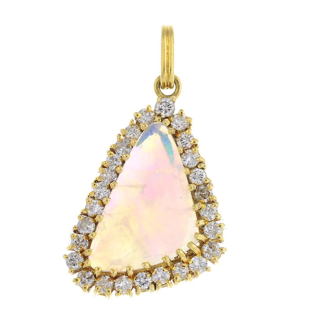 An opal and diamond cluster pendant. The free-form