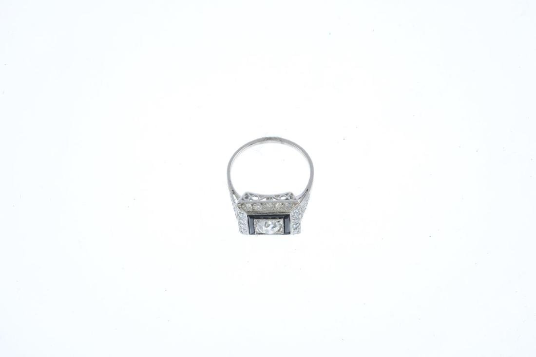 A diamond and onyx dress ring. The old-cut diamond, - 3