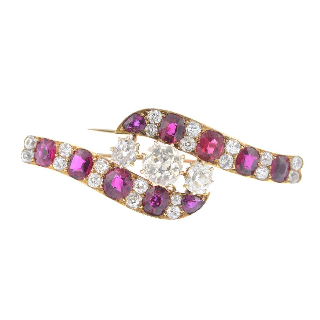 An early 20th century gold diamond and ruby brooch. The