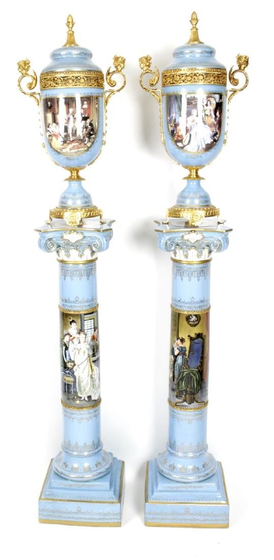 A pair of reproduction Sevres style vases and covers,