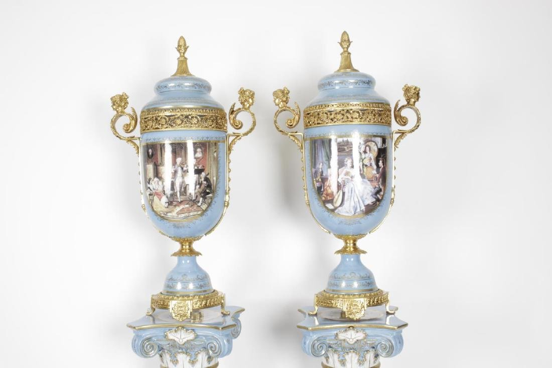 A pair of reproduction Sevres style vases and covers, - 2