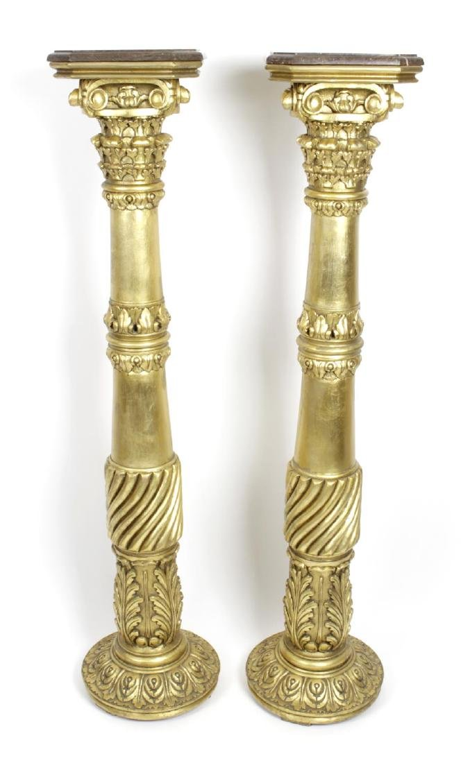 A pair of reproduction carved gilt wooden torchere