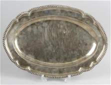 An early George III silver meat dish, the shaped oval