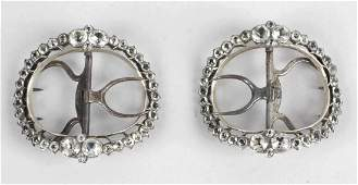 A pair of Georgian paste buckles each of oval outline