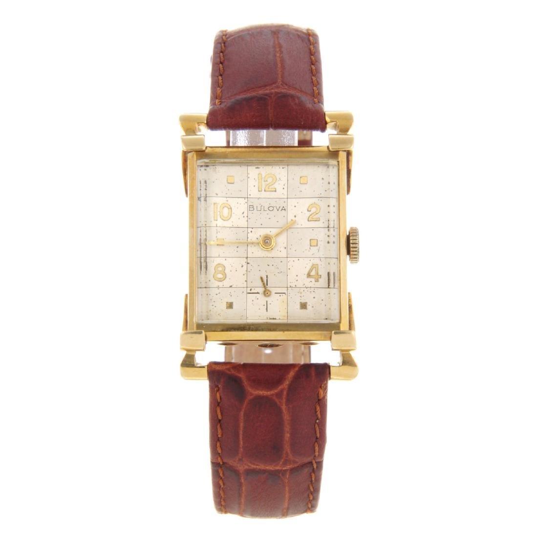 BULOVA - a mid-size wrist watch. Yellow metal case,
