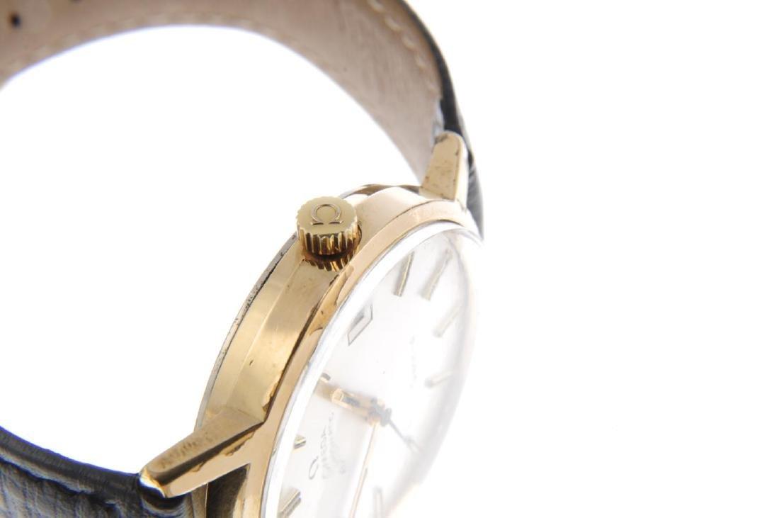 OMEGA - a gentleman's Genève wrist watch. Gold plated - 4