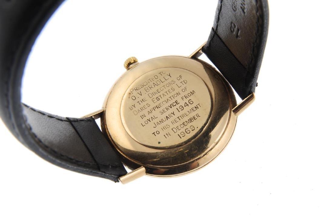 OMEGA - a gentleman's Genève wrist watch. 9ct yellow - 2
