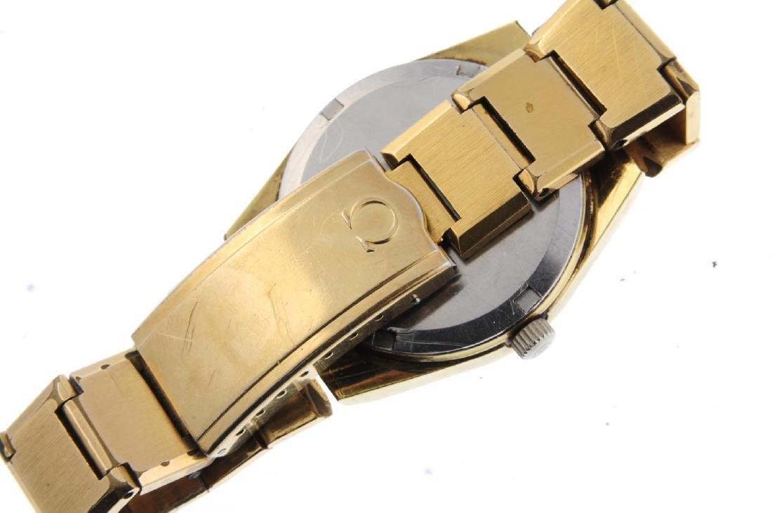 OMEGA - a gentleman's Genève bracelet watch. Gold - 2