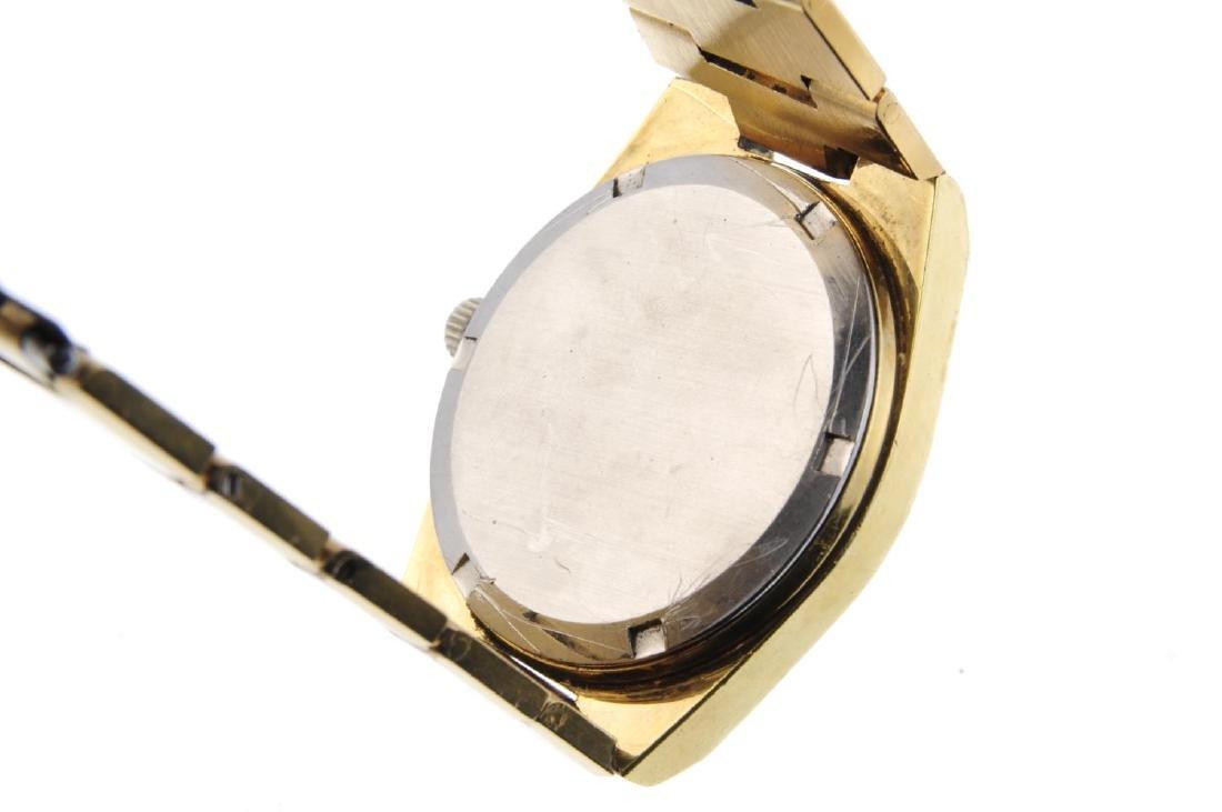 OMEGA - a gentleman's Genève bracelet watch. Gold - 4