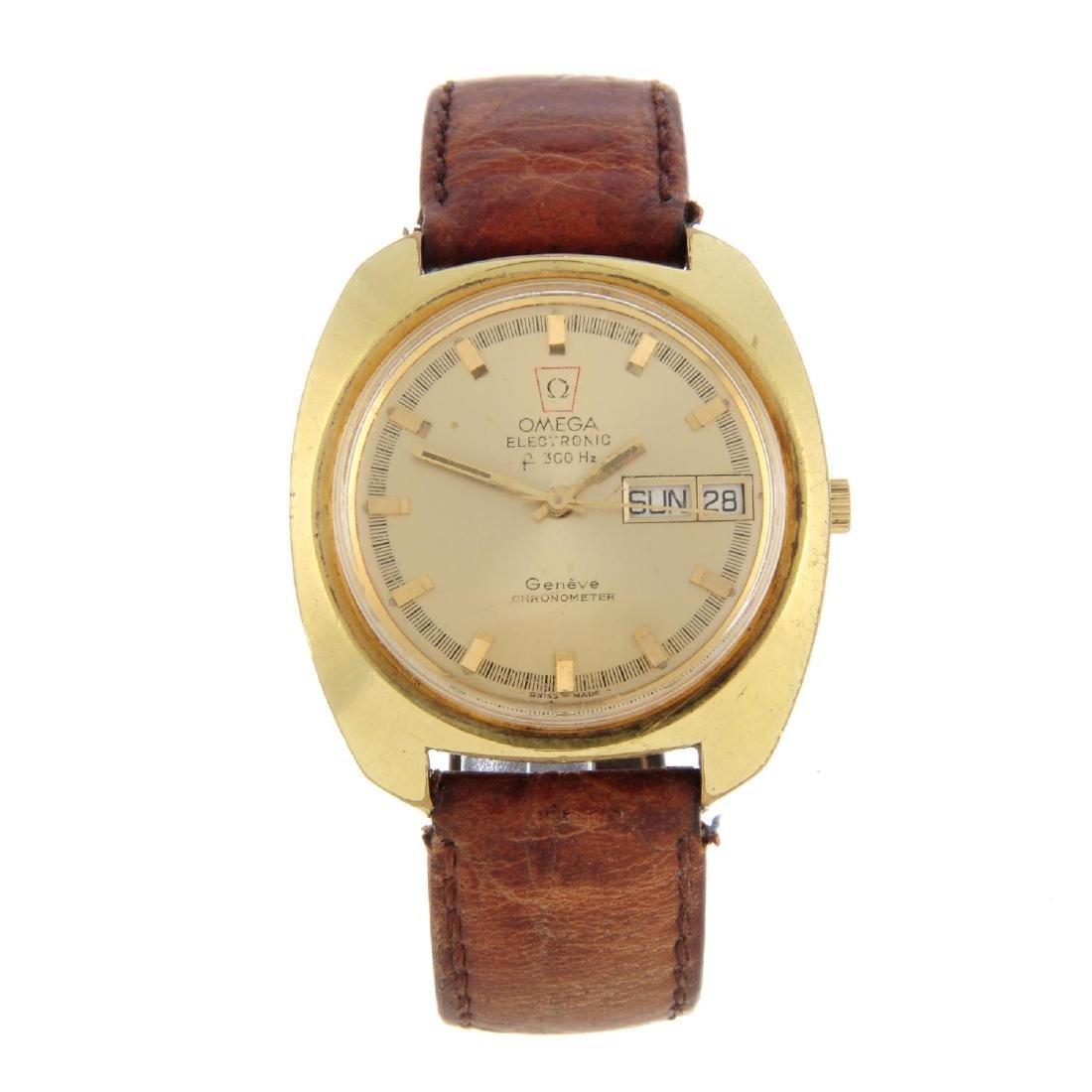 OMEGA - a gentleman's Genève F300 Hz wrist watch. Gold