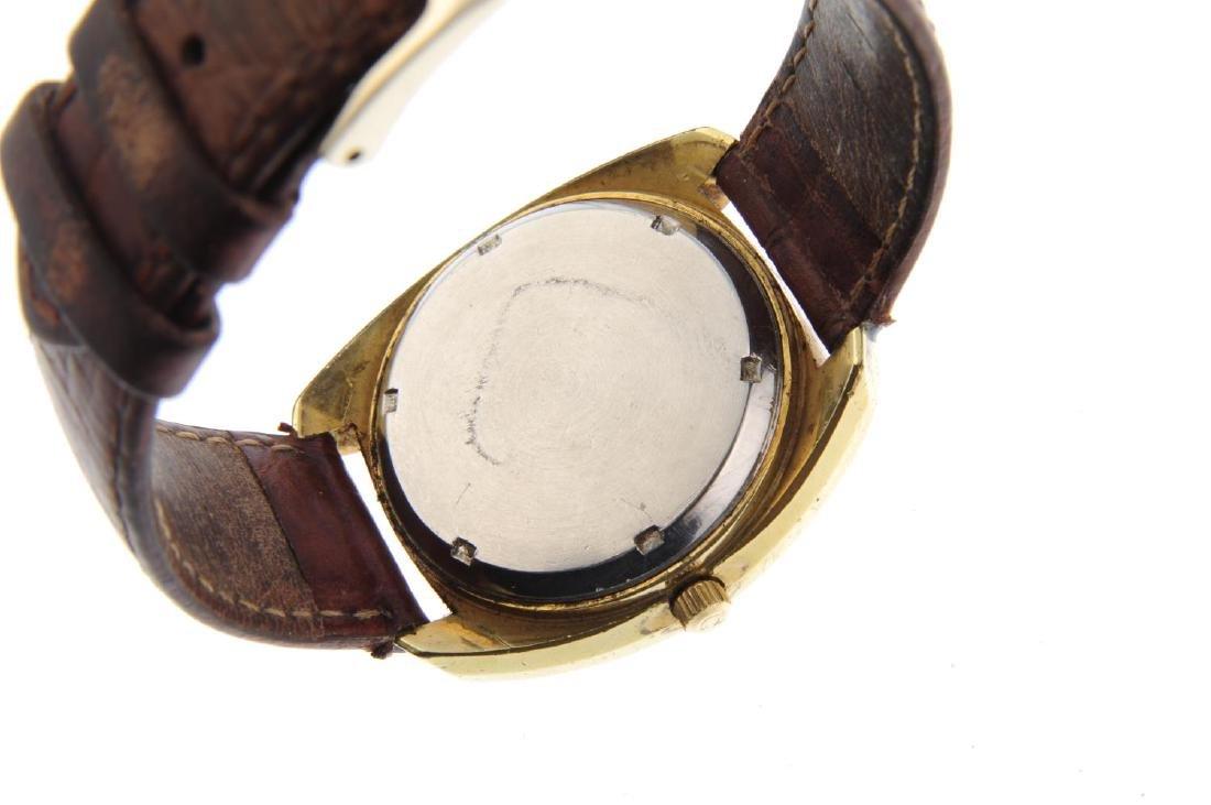 OMEGA - a gentleman's Genève F300 Hz wrist watch. Gold - 3