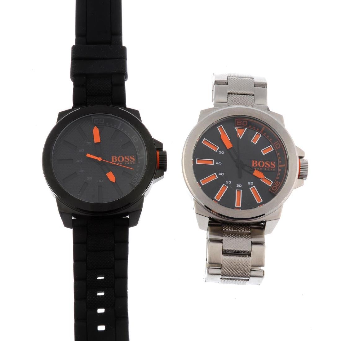 A bag of assorted Boss watches. All recommended for
