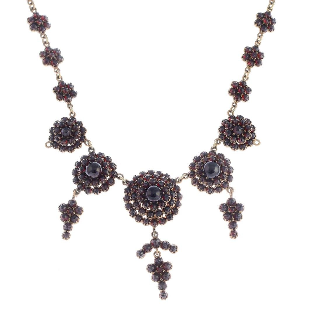A late Victorian garnet necklace. Designed as a series