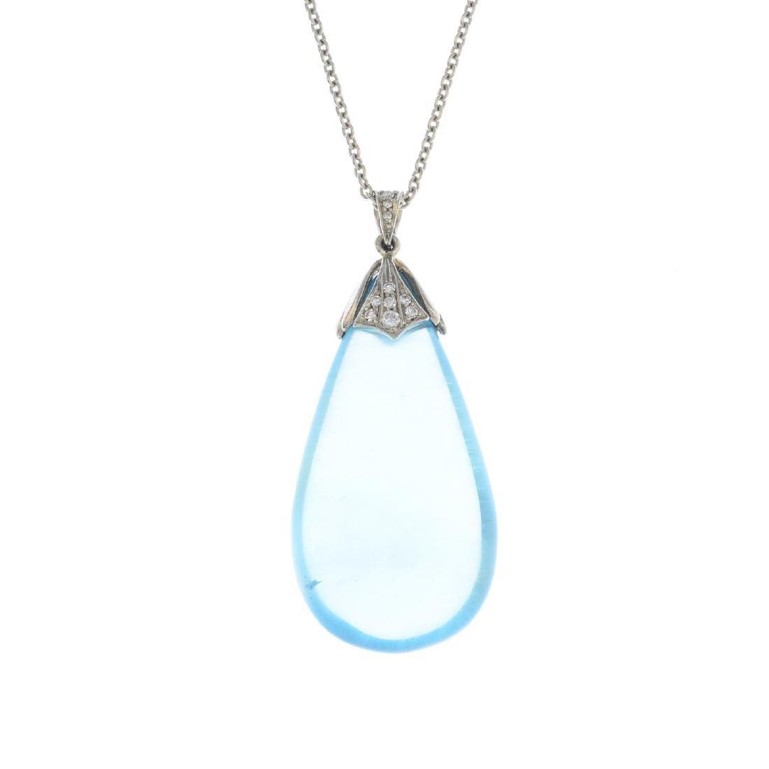 An aquamarine and diamond pendant. Designed as a