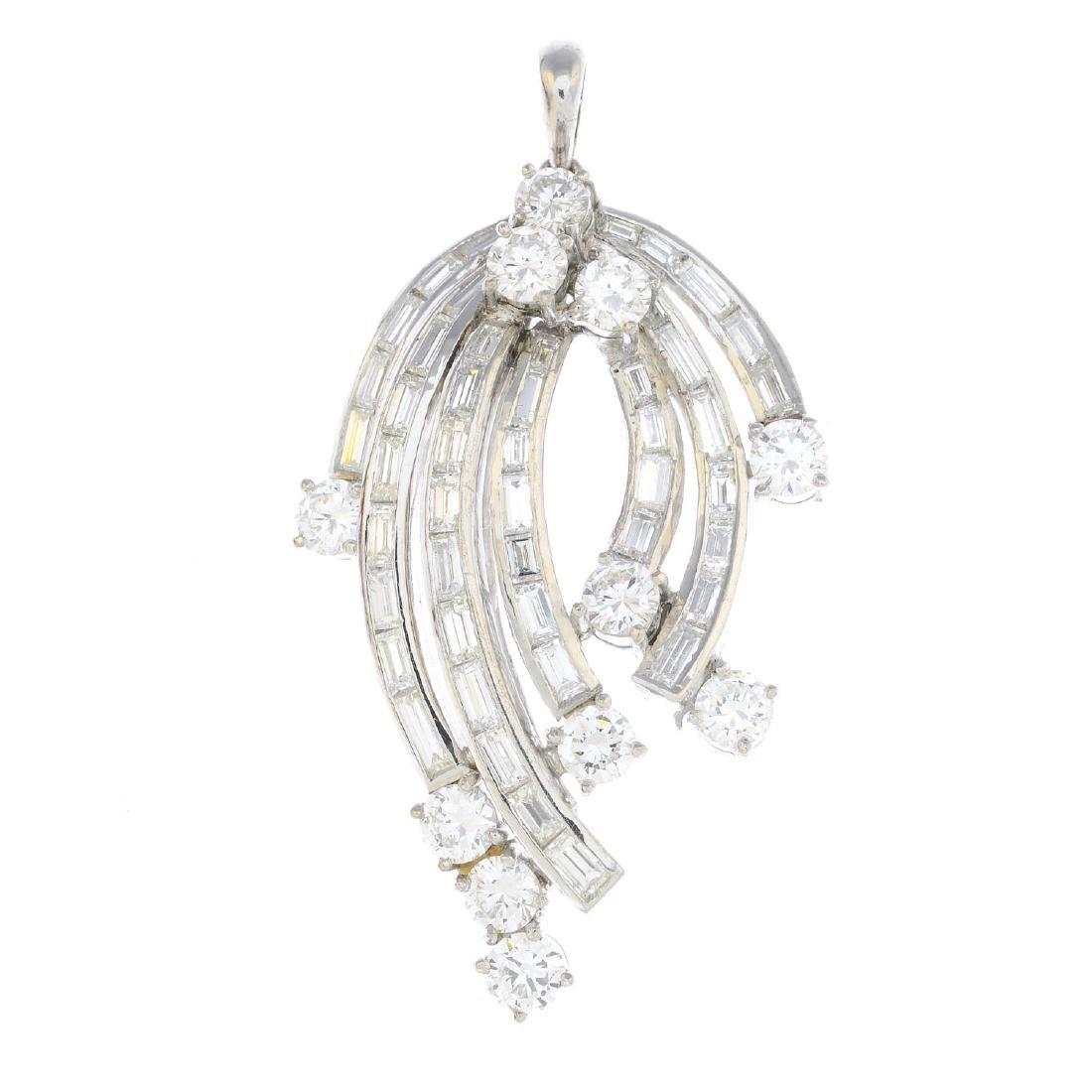 A diamond pendant. Designed as a series of baguette-cut