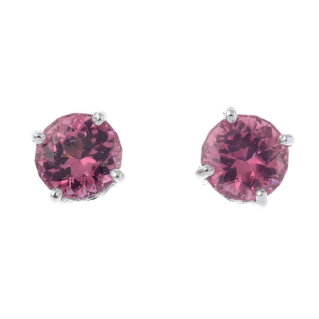 A pair of spinel stud earrings. Each designed as a