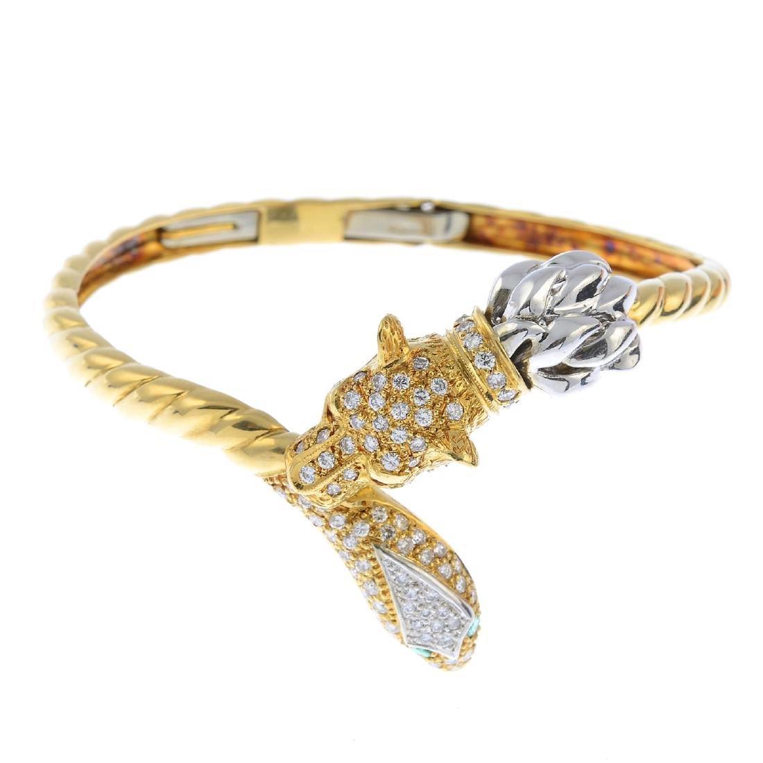 A diamond, ruby and emerald bangle. Of bi-colour