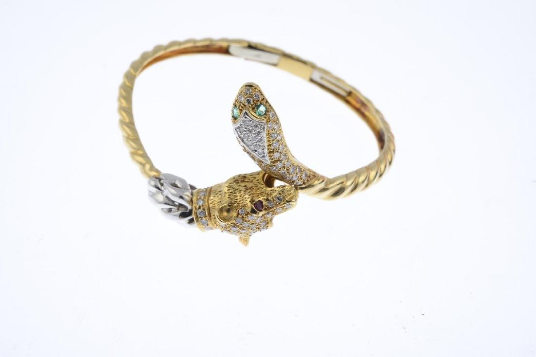 A diamond, ruby and emerald bangle. Of bi-colour - 2