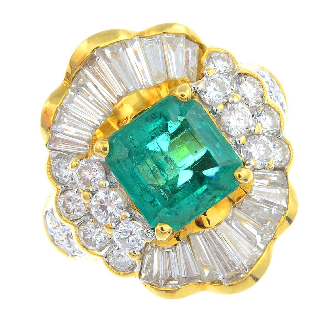 An emerald and diamond dress ring. The