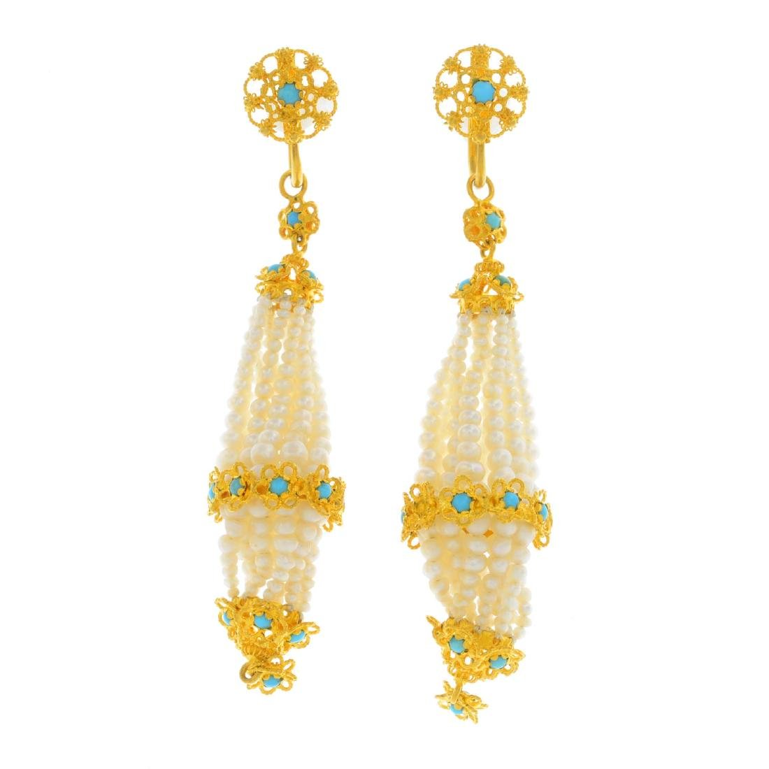 A pair of turquoise and seed pearl earrings. Each