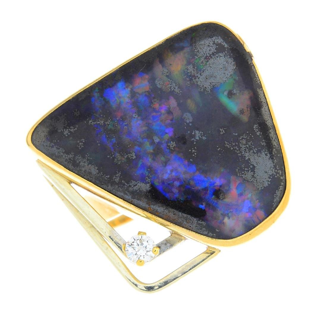 A boulder opal and diamond dress ring. Of abstract