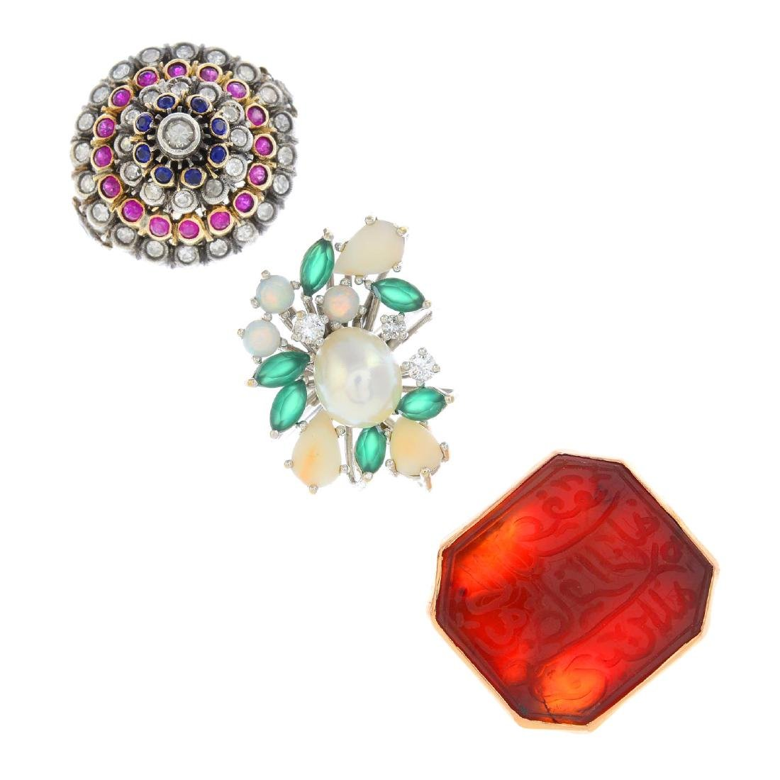 Three gem-set rings. To include a diamond, sapphire and