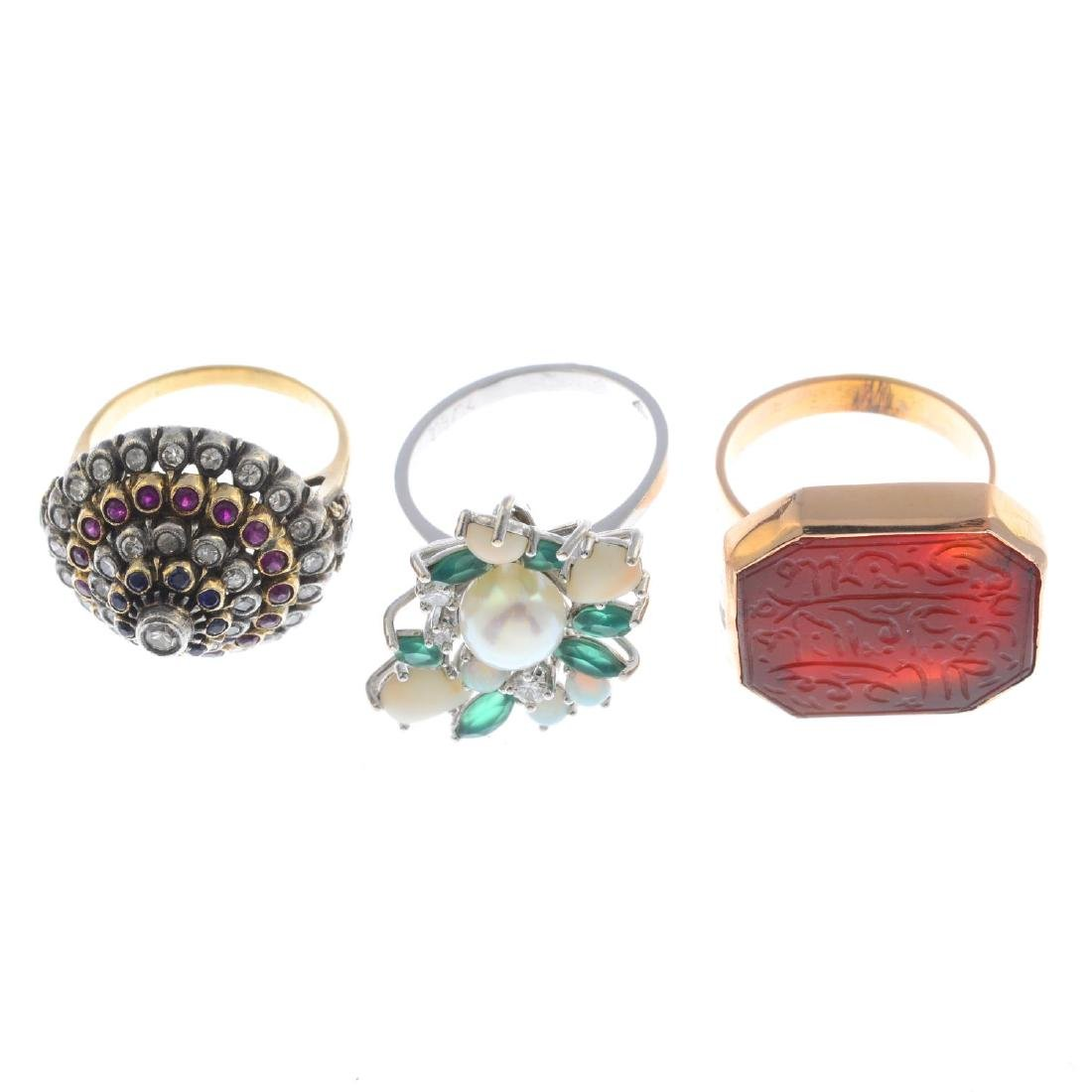 Three gem-set rings. To include a diamond, sapphire and - 3