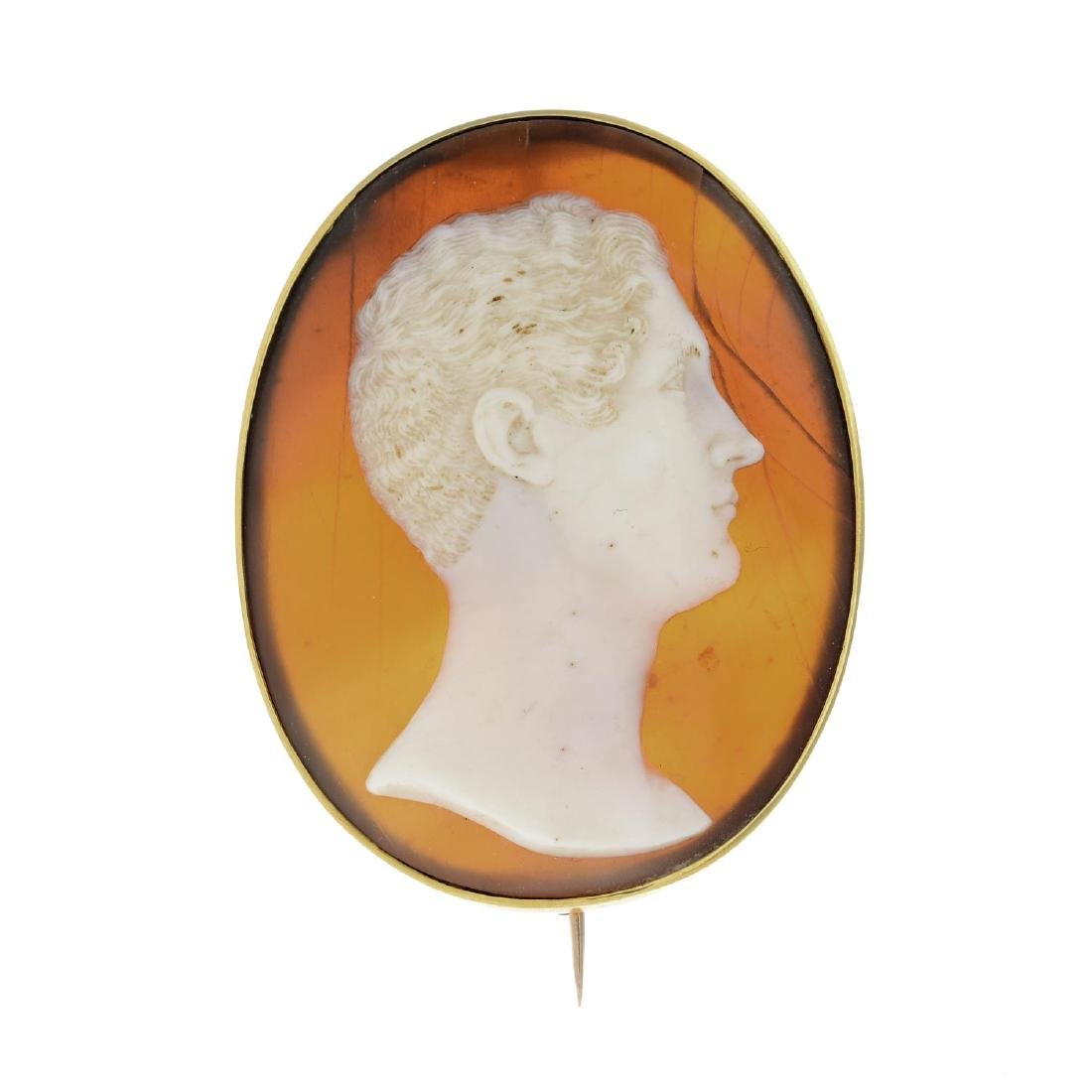 An early Victorian gold shell cameo brooch. The oval