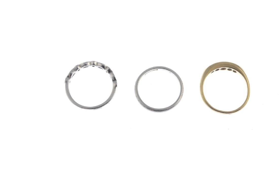 Two diamond rings and a band ring. To include a - 3