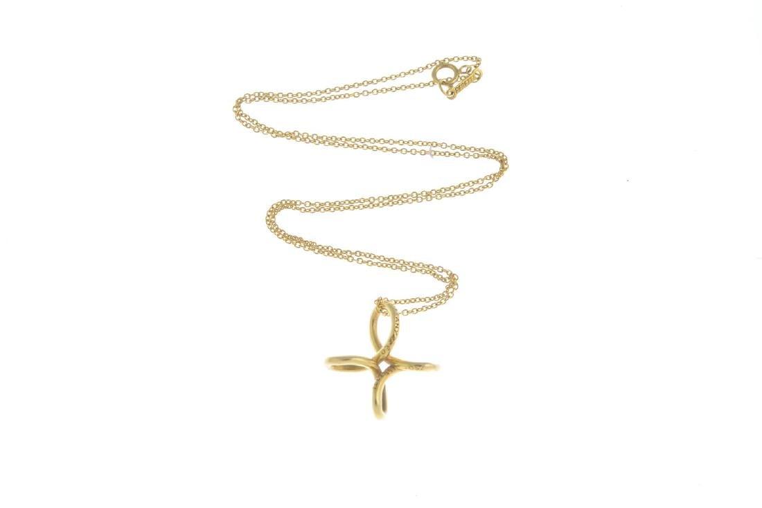 TIFFANY & CO. - a pendant. The openwork cross, - 2