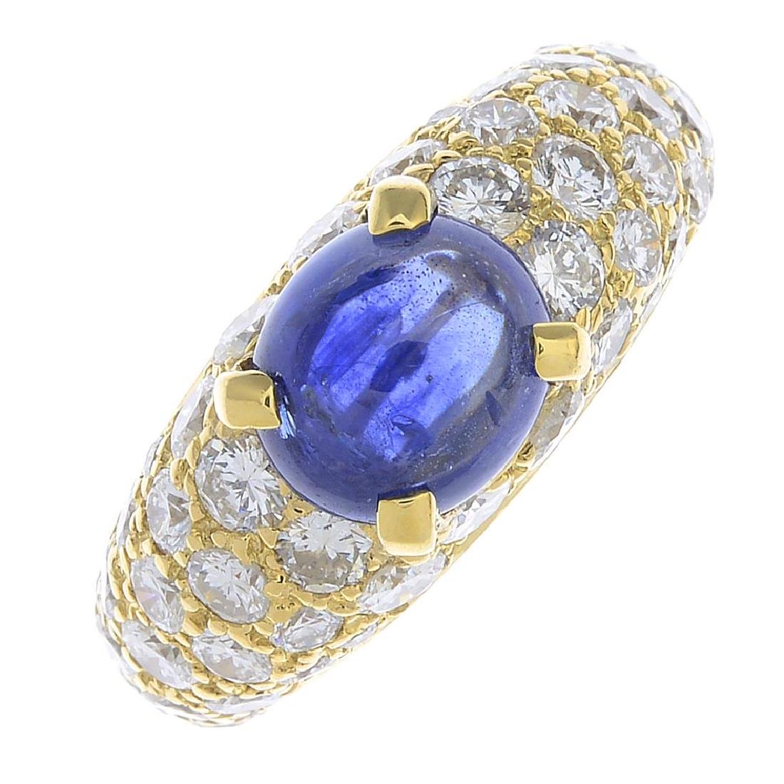 A sapphire and diamond dress ring. The oval sapphire