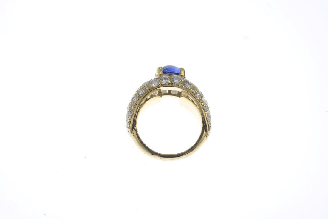 A sapphire and diamond dress ring. The oval sapphire - 2
