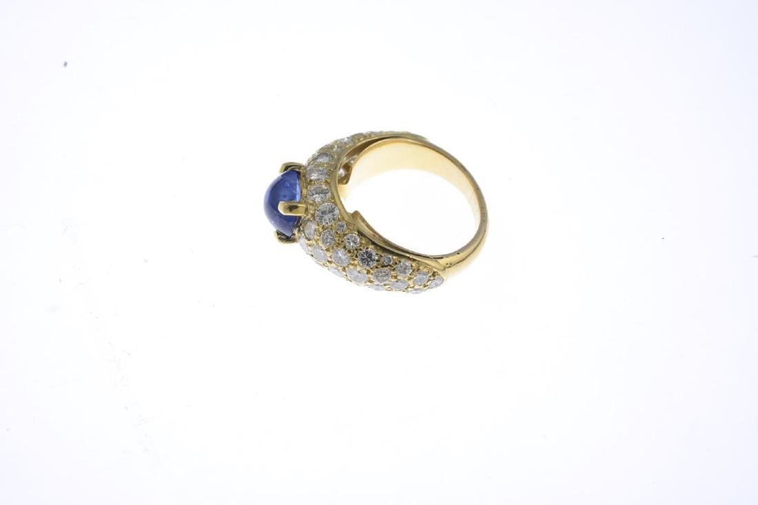 A sapphire and diamond dress ring. The oval sapphire - 3