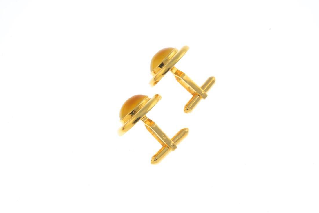 A pair of chrysoberyl cufflinks. Each designed as an - 2