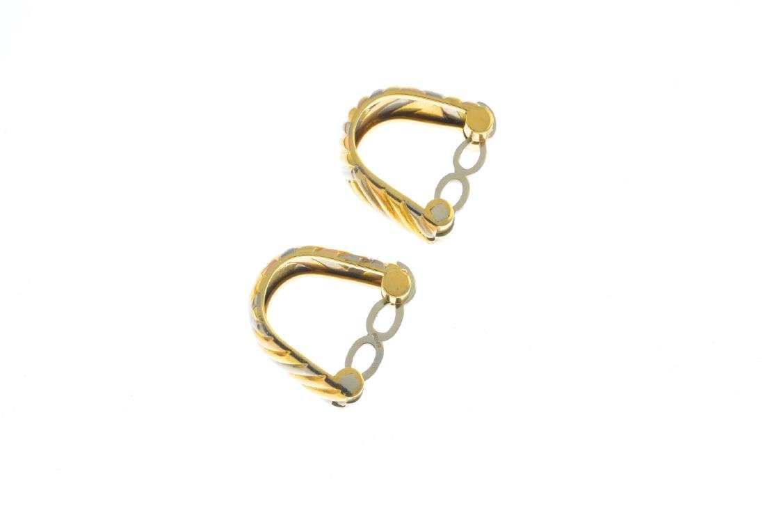 A pair of chrysoberyl cufflinks. Each designed as an - 4
