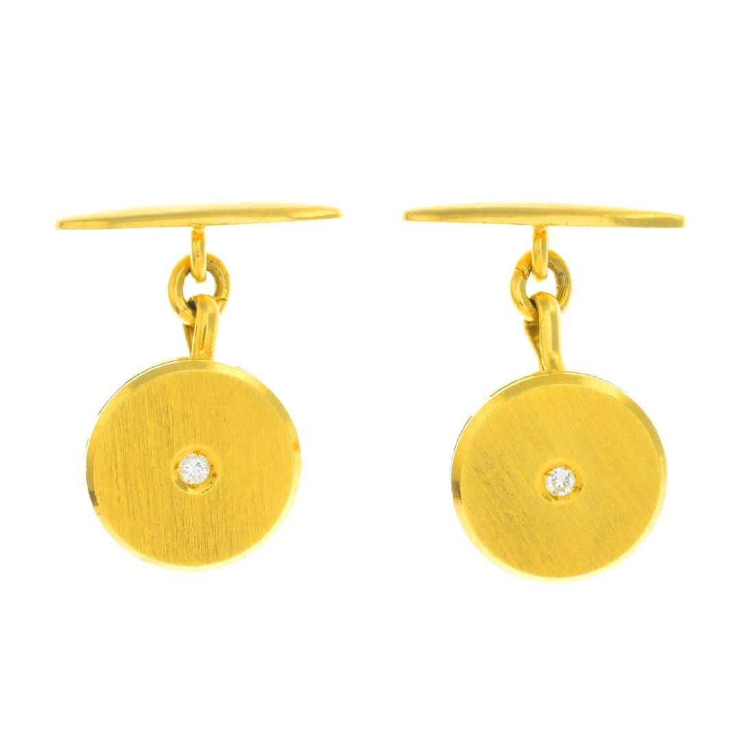 A pair of diamond cufflinks.  Each designed as a