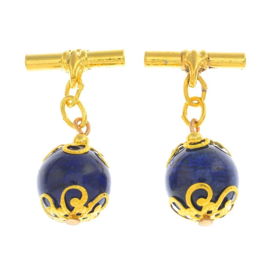A pair of lapis lazuli cufflinks. Each designed as a