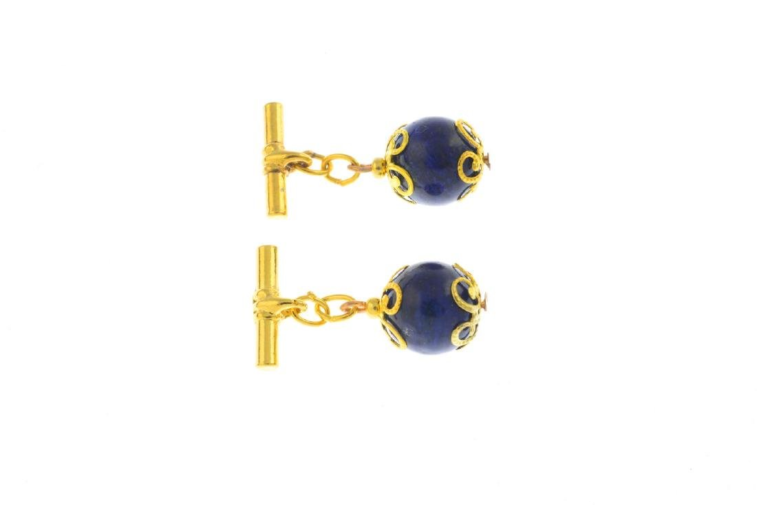 A pair of lapis lazuli cufflinks. Each designed as a - 2