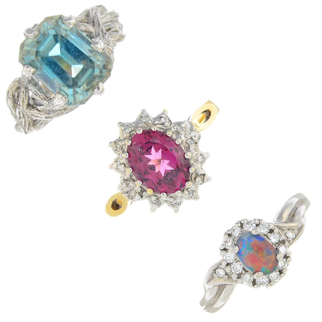 A selection of three gem-set rings. To include a 9ct