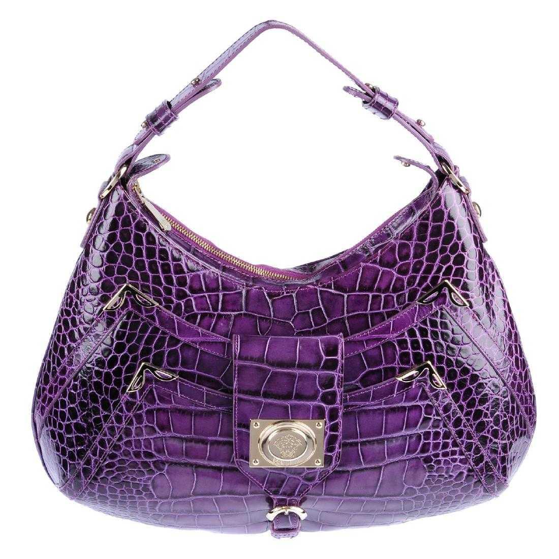 678d7f34f2 VERSACE - an embossed crocodile leather handbag.